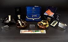 Mixed Lot Of Collectables And Watches, Comprising Swatch, Tissot Seiko 5 Wristwatches. Also boxed vintage 'Sunny' cigarette lighter by Noble, two silver tone lighters, four Murano style glass ashtrays, card games and boxed simulated pearl collar