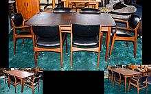 1970's Dining Room Set comprising of a dining extending table in typical 1970's Modernist form, unextended length 60 inches, width 35 inches, Together with 6 chairs (including 2 carvers) with black leather seats and back rests and teak wood frames.