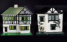 Two Two Tier Wooden Constructed Tudor Style Dolls Houses with a small amount of furniture. One measuring 26 by 26 inches and wired for lights, the other a smaller Tudor style cottage with carpeted floors measuring 16 by 19 inches.