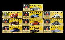 A Collection Of Vanguards Cars 10 in total. Including B.S.M Herald, Pale Green Ford Anglia, Pale Blue VW Cabriolet, VW Split Screen Beetle, Polizei Beetle, Brooke Bond PG Tips Van, Navy Ford Anglia, 2 Black Morris Minor Traveller and Red Triumph
