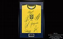 Football Interest Autographed Brazil 1970 World Cup Winners Shirt A rare and immaculately presented piece, framed and mounted under glass, complete with etched plaque to bottom centre, Original Nike Brasil Cotton t-shirt signed to front by Pele,