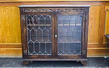 Oak Jacobean Style Carved Bookcase, leaded glazed front with 2 shelves. 36 inches high, 39 inches wide and 13 inches deep.