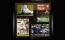 Football Interest David Beckham Autographed Photo Display Framed and mounted under glass with etched gold tone plaque to bottom centre, titled 'Beckham Saves The Day', contains a group of images in celebration of the 2002 World Cup Qualifier. Signed
