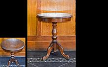 Antique Scandinavian Occasional Table Small mahogany table with trefoil carved legs and circular top. Height, 24 inches