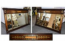 A Large Mirrored Overmantle Panel Antique neoclassical style overmantle mirror with brass foliate inlay to top centre and sides. Comprises three glazed mirrored panels with gilt beading. Good condition, 27 inches in height, 48 inches in length