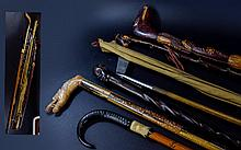 A Collection Of Antique Walking Sticks, Golf Putter And Fishing Rod Seven items in total to include carved African stick with male head pommel,horn handle 'Vampire' stick with stake bottom, horn handle and hoof detail to collar, vintage cork fishing