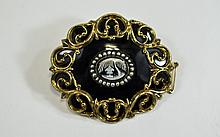 A Finely Worked and Well Made Victorian Black Enamel and Pinchbeck Oval Sha