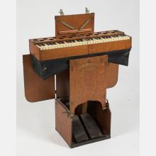 A Wonder Portable Pump Organ Manufactured by C.G. Conn, Elkhart IN, 20th Century,