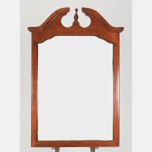 A Chippendale Style Cherry Beveled Mirror, 20th Century.
