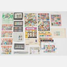 A Collection of Worldwide Stamps in Philatelic Presentation Packets, 20th Century.