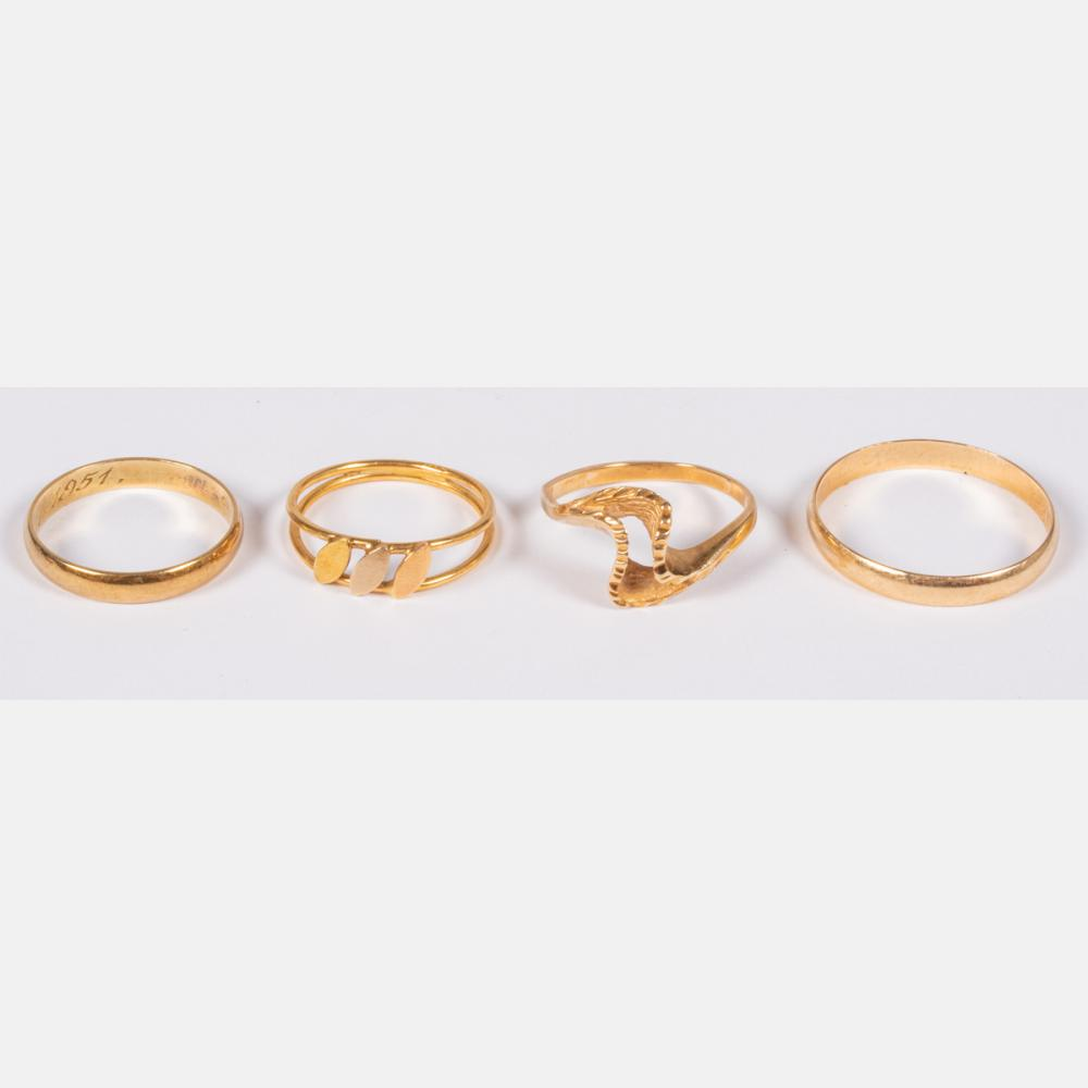 Three 14kt Yellow Gold Rings Together with an 18kt Yellow Gold Ring,