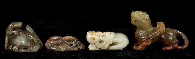 A Group of Four Chinese Carved Jade and Hard Stone Animal Figures Depicting a Winged Mythical Creature and Three Lion Figures.