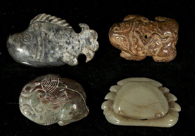 A Group of Four Chinese Carved Jade and Hard Stone Animal Figures Depicting Two Frogs, Two Fish, and a Crab.