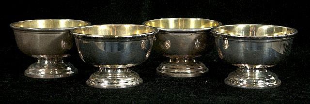 A Set of Four Sterling Silver Master Salts by Richard Dimes Co. and Howard & Company,
