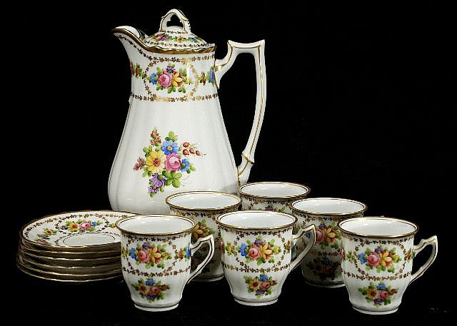 A German Porcelain Chocolate Set for Six, 20th Century,