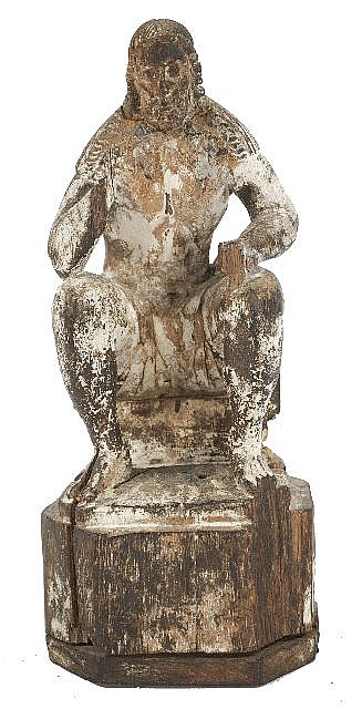 A Spanish Colonial Carved and Painted Figure of a Seated Saint, 19th Century.