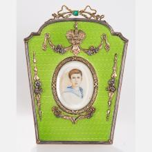 A Russian Style Gilt Silver and Green Guilloche Enameled Frame with a 0.25ct. Emerald, 20th Century,