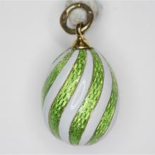 A Fabergé Style White and Green Guilloche Enameled Miniature Egg Form Pendant, 20th Century,