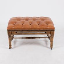 A Georgian Style Tufted Leather and Stained Hardwood Ottoman with Pullout Slide, 20th Century.