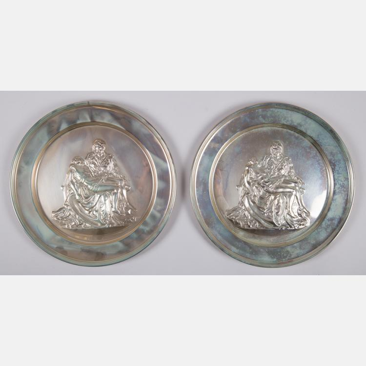 Two Sterling Silver 'Pieta' Plates by Danbury Mint, 20th Century.