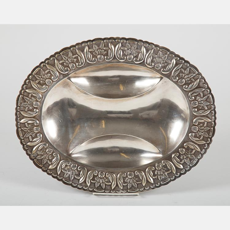 A Sterling Silver Platter with Repousse Decoration, 20th Century.