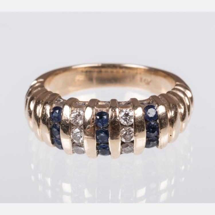 A 14kt. Yellow Gold, Diamond and Sapphire Ring,