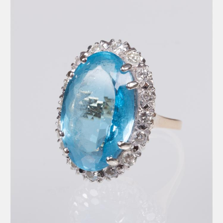 A 14kt. Yellow Gold, Blue Topaz and Diamond Ring,