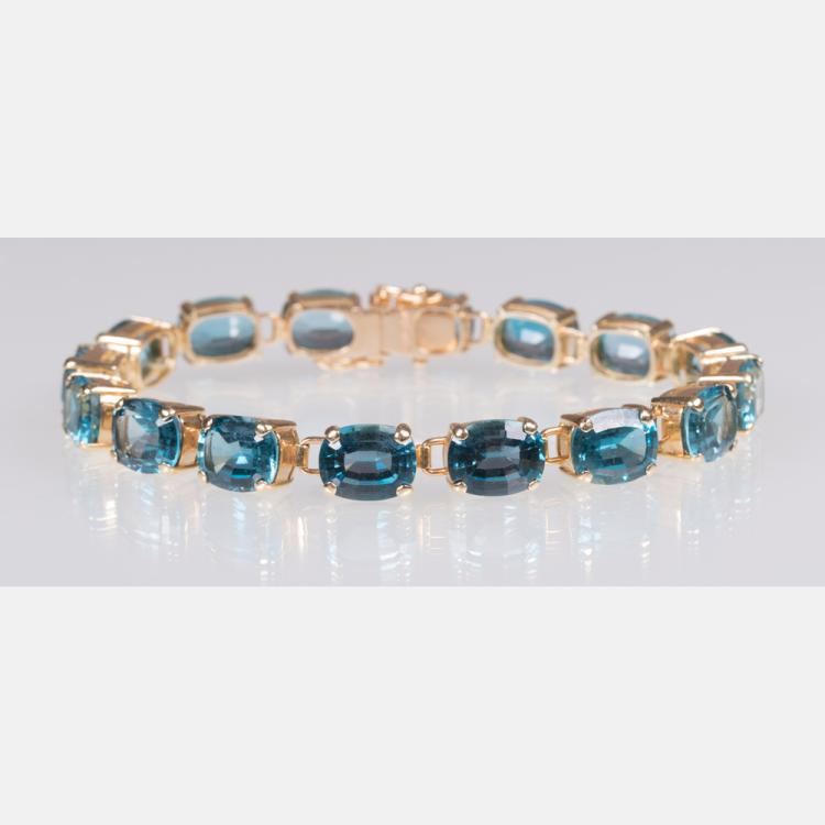 A 14kt. Yellow Gold and Blue Topaz Link Bracelet,
