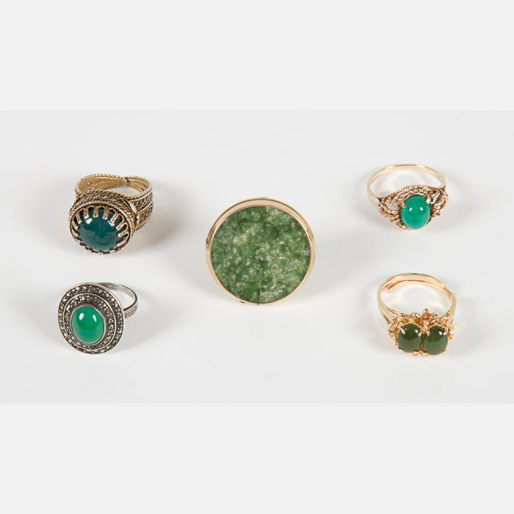 A Group of Five Low Karat Yellow Gold, Silver and Gold Plated, Jade Rings.