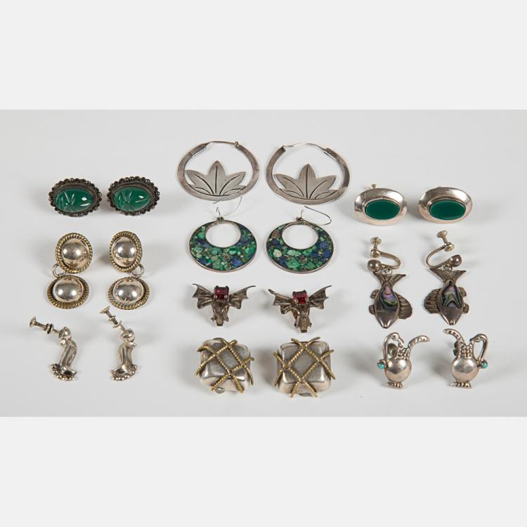 A Collection of Ten Pairs of Mexican Silver and Sterling Silver Earrings.