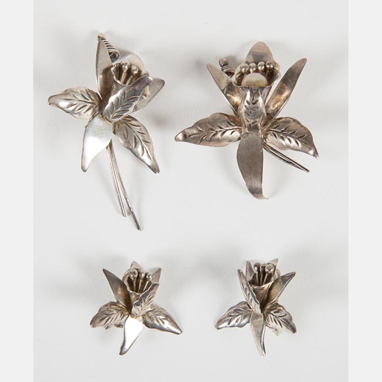A Suite of Taxco Mexican Sterling Silver Orchid Form Jewelry,