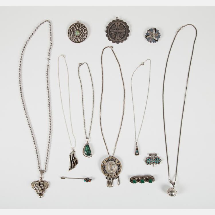 A Miscellaneous Collection of Mexican Silver and Sterling Silver Pendants, Brooches and Necklaces,