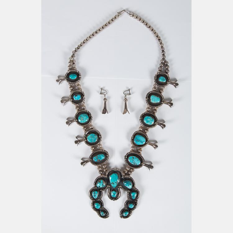 A Navajo Silver and Turquoise Squash Blossom Necklace and matching pair of Earrings.