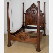 An American Victorian Carved Mahogany Four Poster Bed, 19th Century.
