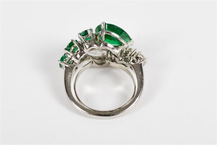 PLATINUM, DIAMOND, AND EMERALD BYPASS RING