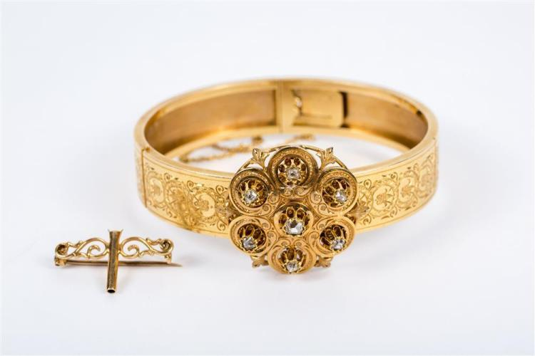 14K YELLOW GOLD BANGLE BRACELET WITH DIAMOND-SET ORNAMENT/BROOCH .