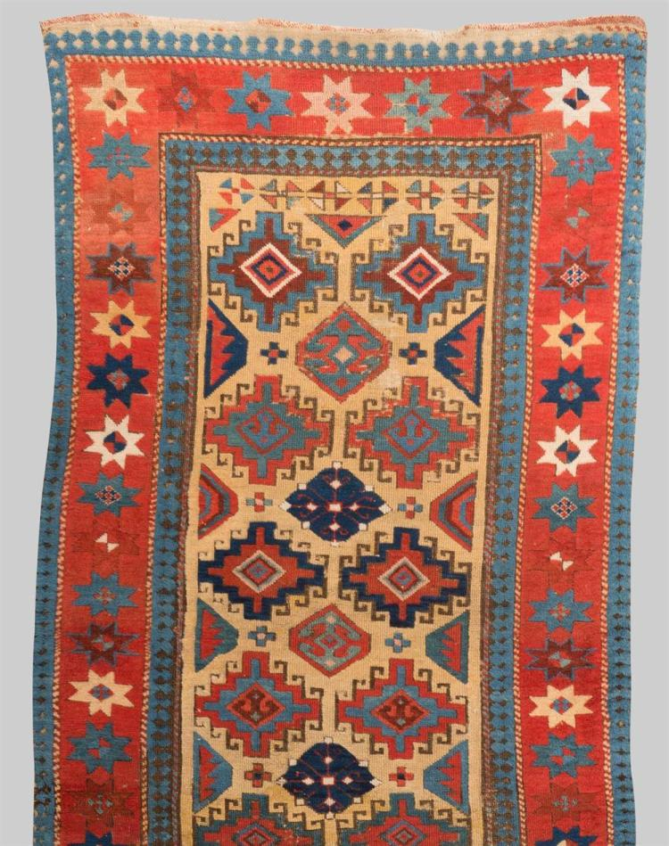 SOUTH CAUCASIAN RUG; mid 19th century; 8 ft. 10 in. x 3 ft. 4 in.
