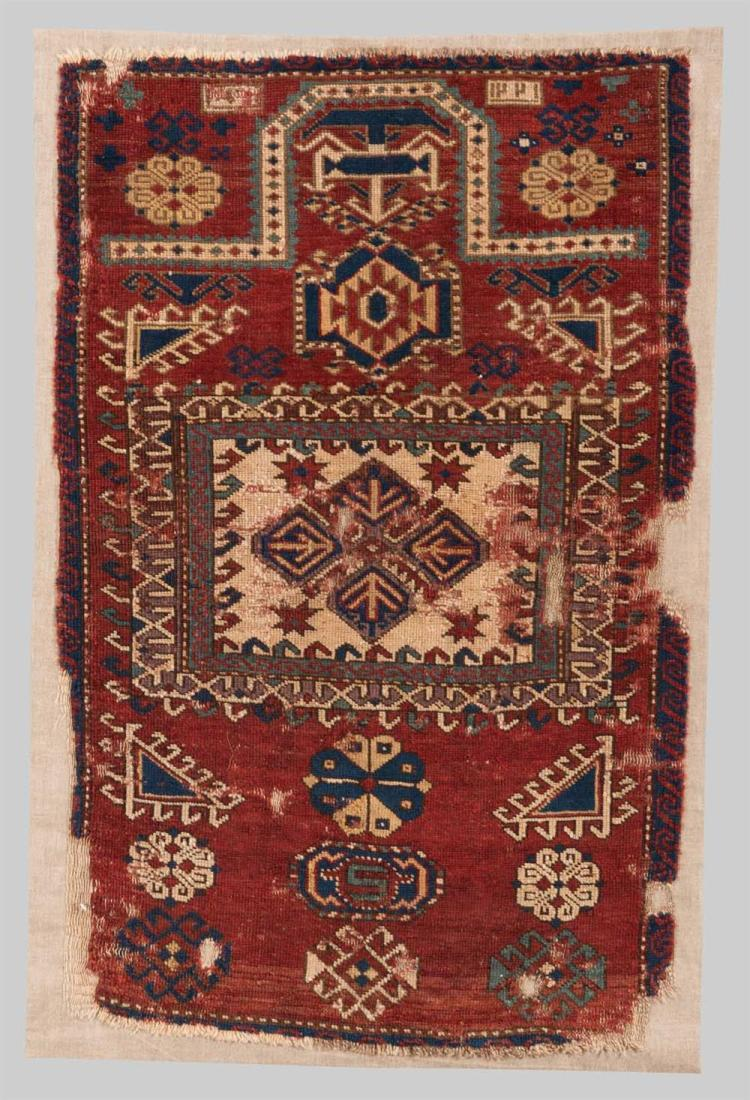 CAUCASIAN PRAYER RUG, dated AH 1221, probably early 20th century; 3 ft. 6 in. x 2 ft. 3 in.