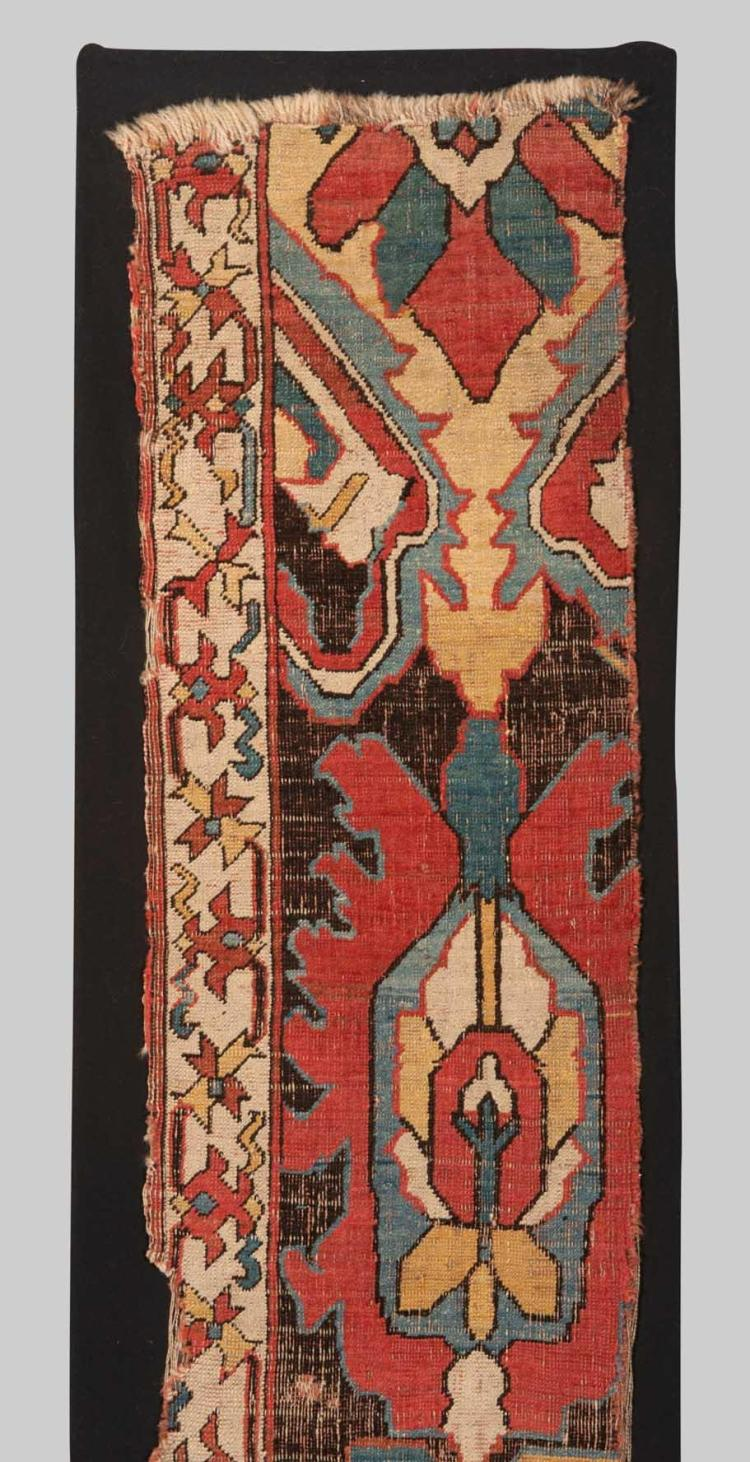 CAUCASIAN BLOSSOM CARPET FRAGMENT, 17th/18th century; 7 ft. 2 in. x 1 ft. 5 1/2 in., mounted