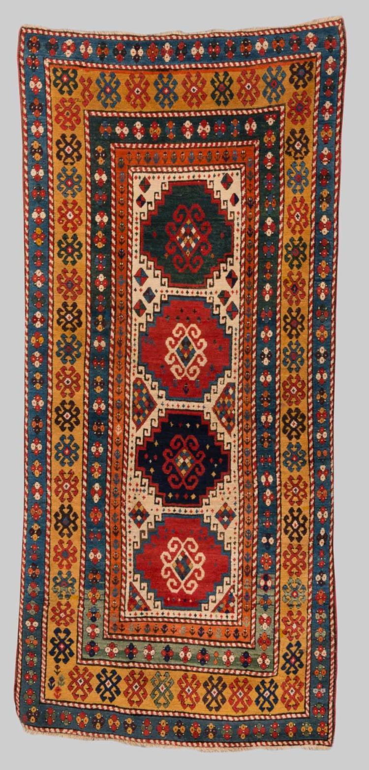 KAZAK RUG, Caucasus, late 19th century; 8 ft. 7 in. x 3 ft. 11 in.