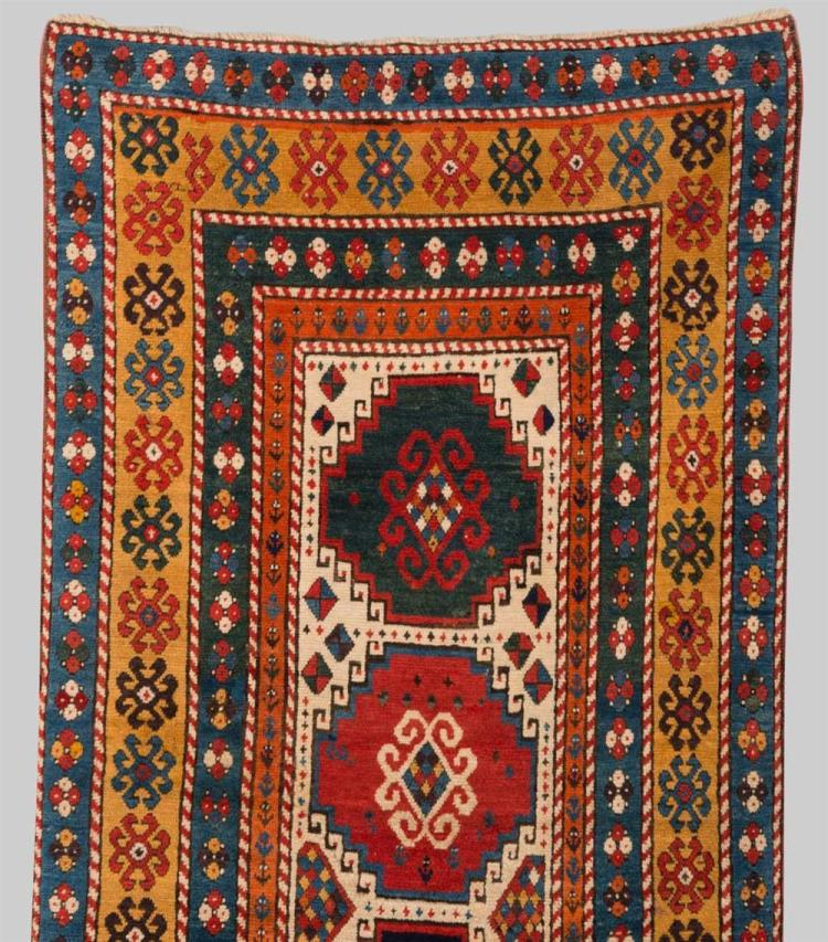 KAZAK RUG, Caucasus, late 19th century; 8 ft. 7 in. x 3 ft. 11 in.