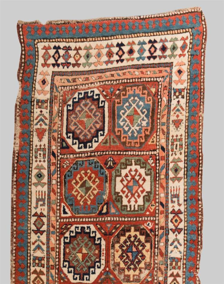 MOGHAN RUG, Caucasus, second half 19th century; 9 ft. 8 in. x 3 ft. 3 in.