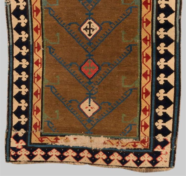 SOUTH CAUCASIAN RUG FRAGMENT, early 19th century; 4 ft. 10 in. x 2 ft. 8 in.
