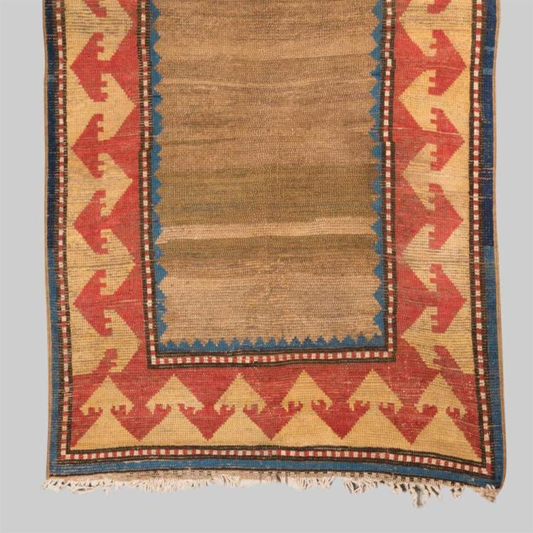 SOUTH CAUCASIAN RUG, first half 19th century; 10 ft. 2 in. x 2 ft. 11 in.