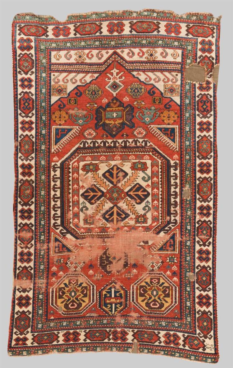 CAUCASIAN PRAYER RUG, early 19th century; 5 ft. 8 in. x 3 ft. 5 in.