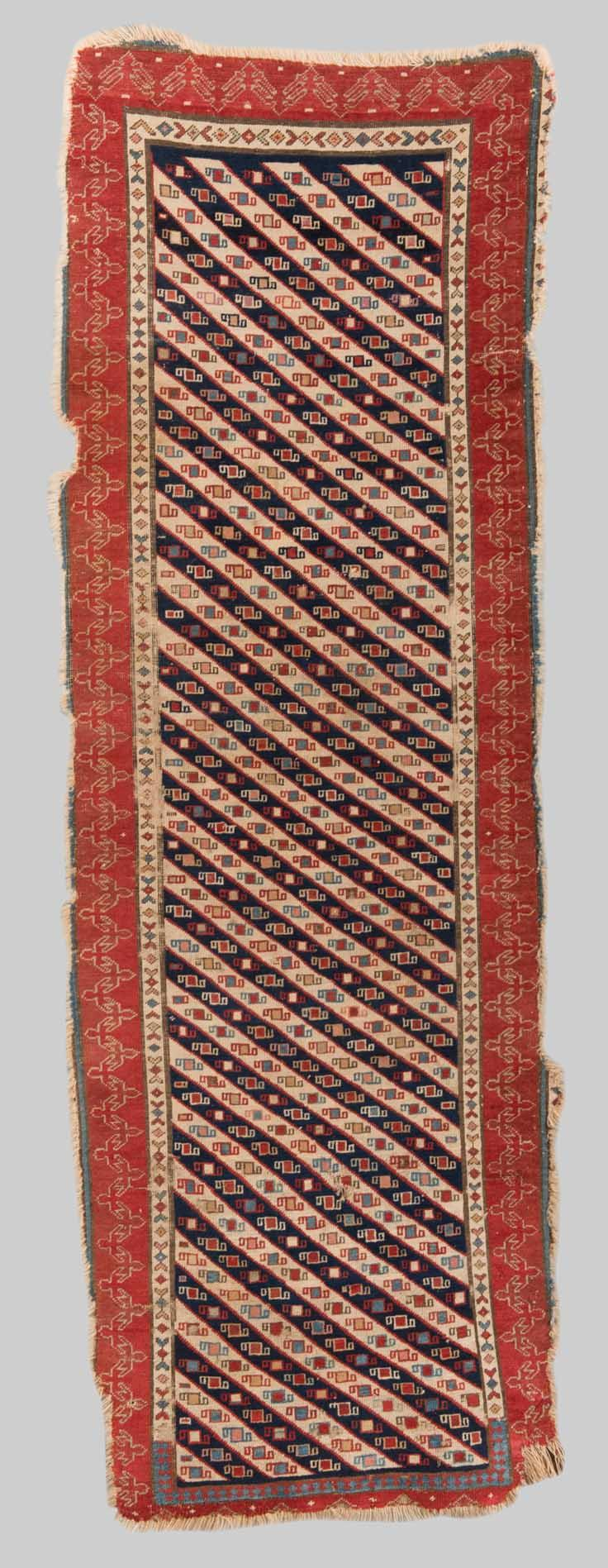 EAST CAUCASIAN RUG, Caucasus, mid 19th century; 7 ft. 9 in. x 2 ft. 7 in.