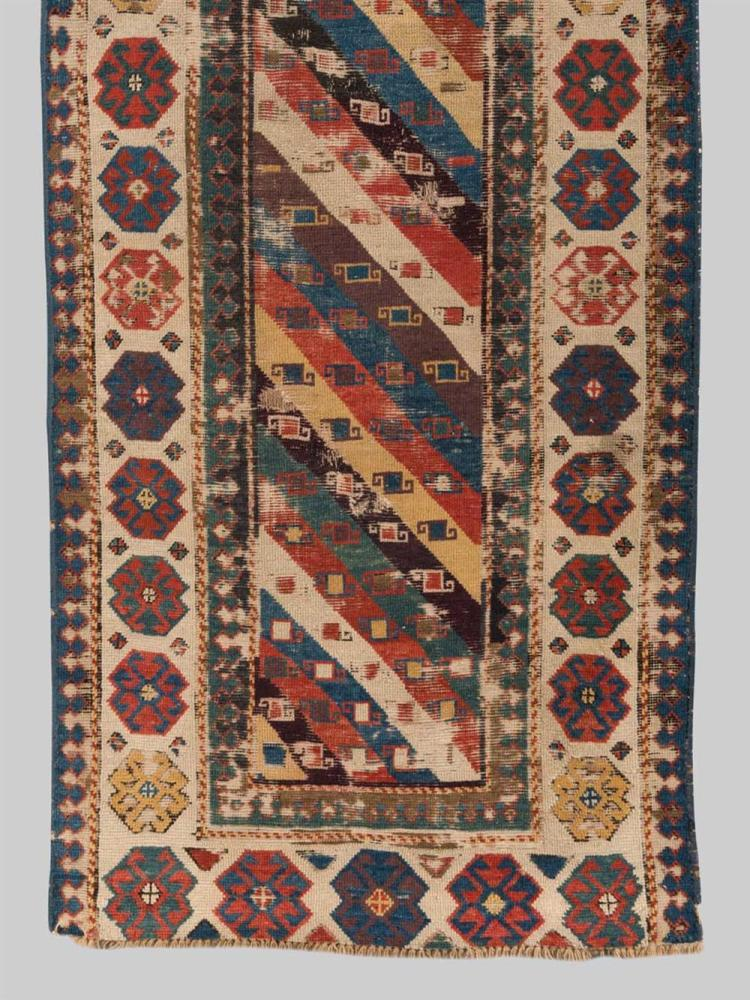 SOUTH CAUCASIAN RUG, first half 19th century; 7 ft. 2 in. x 3 ft.