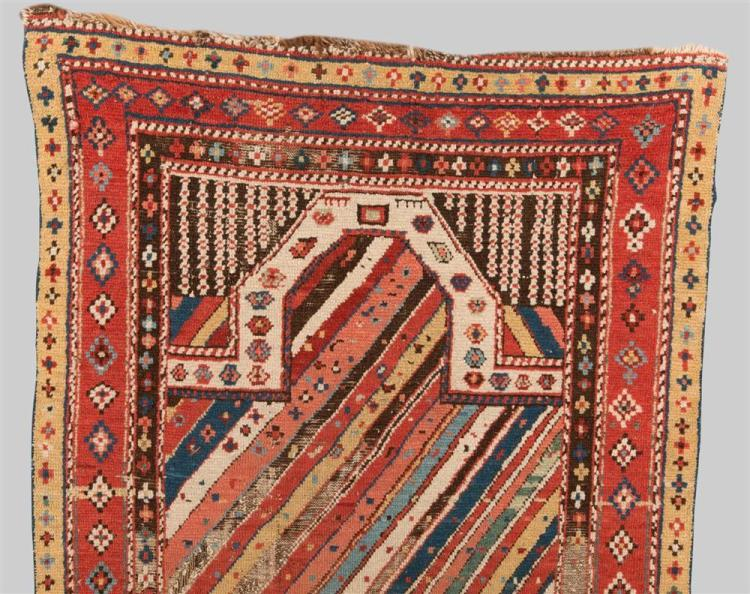 CAUCASIAN PRAYER RUG, early 19th century; 4 ft. 10 in. x 2 ft. 10 in.