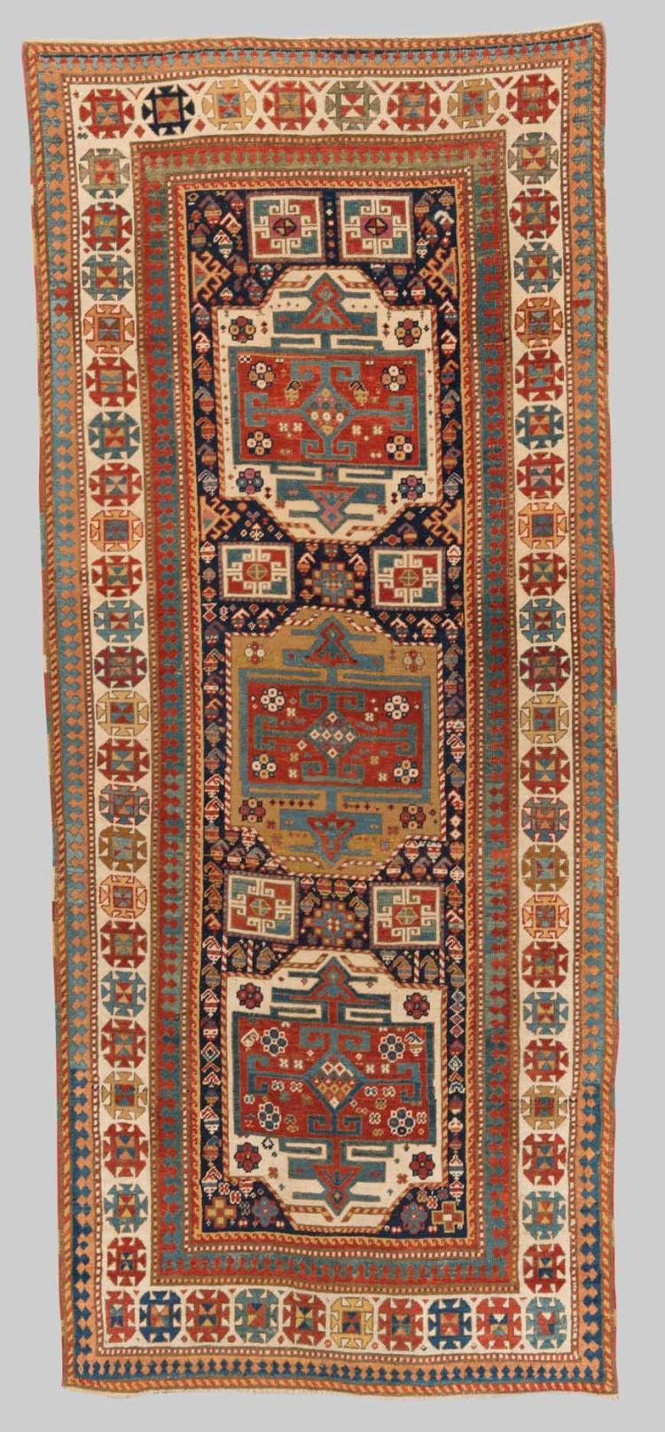 CAUCASIAN RUG, late 19th century; 8 ft. 1 in. x 3 ft. 5 in.