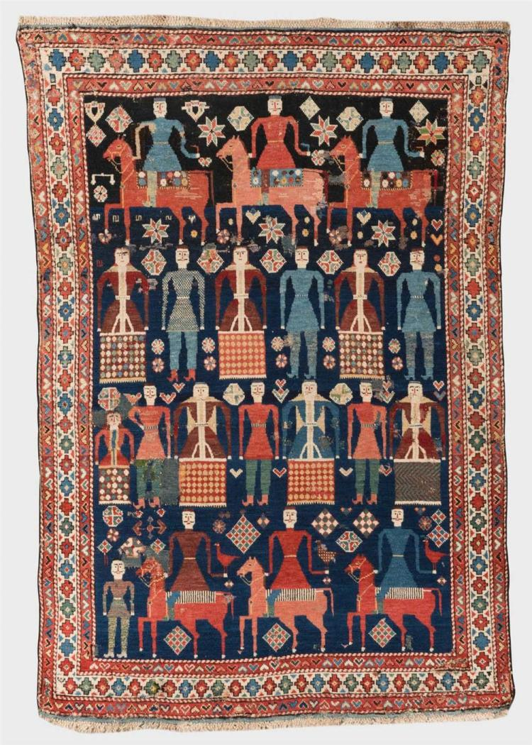 KUBA PICTORIAL RUG, Caucasus, second half 19th century; 5 ft. 7 in. x 3 ft. 11 in.